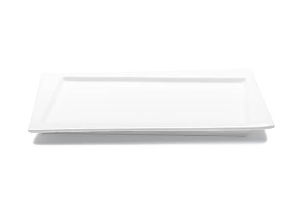 Assiette blanche vide isolé sur fond blanc - Photo