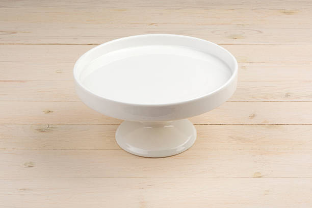 Empty white Plate Empty white cake standing on the wood cakestand stock pictures, royalty-free photos & images