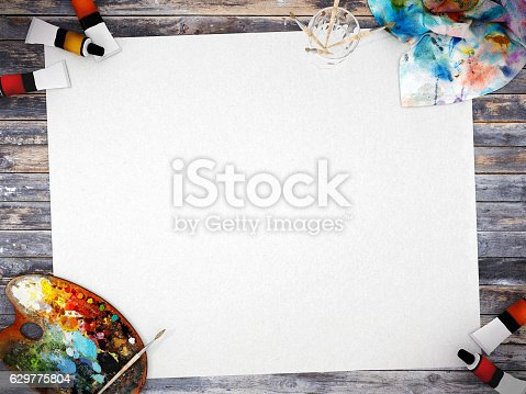 istock Empty white poster paper with painting equipment 629775804