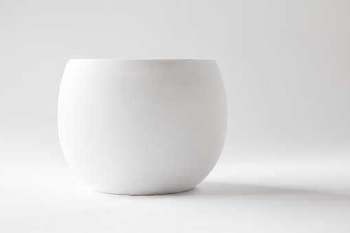Empty white pottery potted plant
