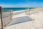 Empty white sandy beach with fences,  Gulf of Mexico coast, Alabama, USA