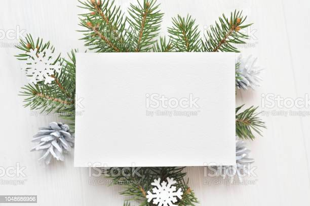 Empty white sheet of paper on a white christmas background of fir picture id1048686956?b=1&k=6&m=1048686956&s=612x612&h=w6 brtnjxonz5igsxoirpf2tzz9jozylx989y6fhtjy=