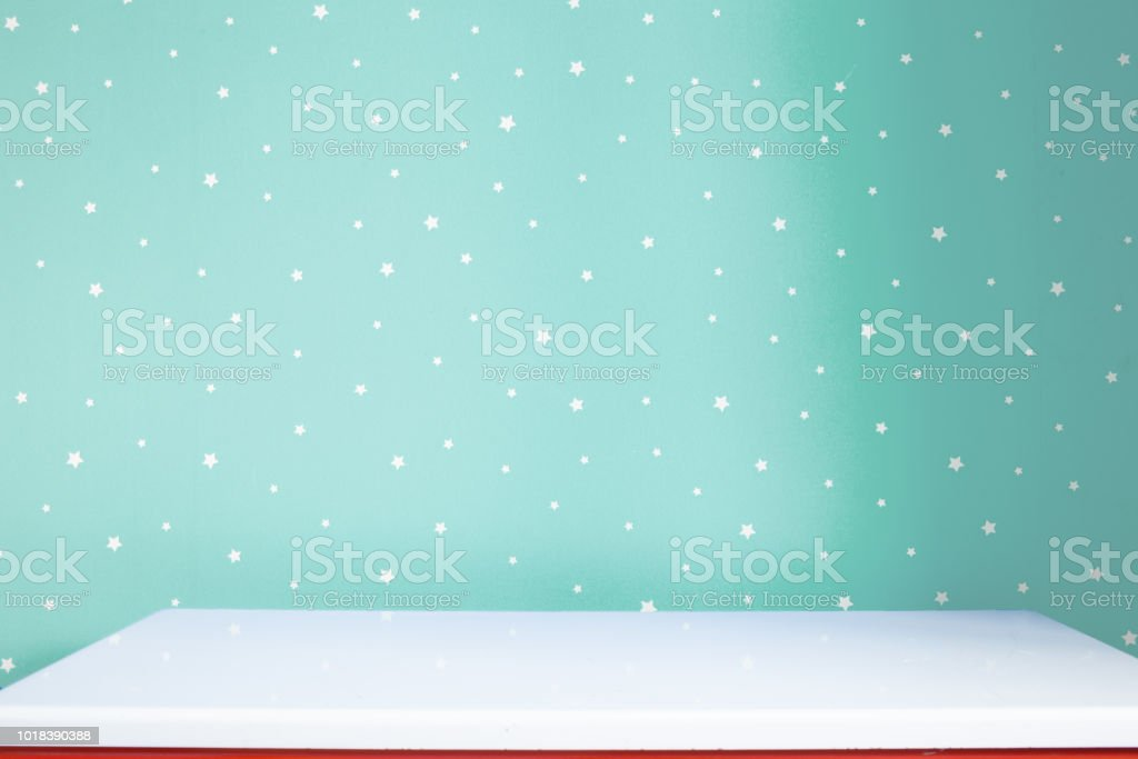 Empty white shelf and soft pastel turquoise starry background in the baby room stock photo