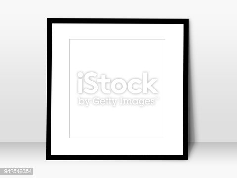 istock empty white space in black blank frame leaning against with white wall. simple blank photo frame for presentation or decorate background 942546354