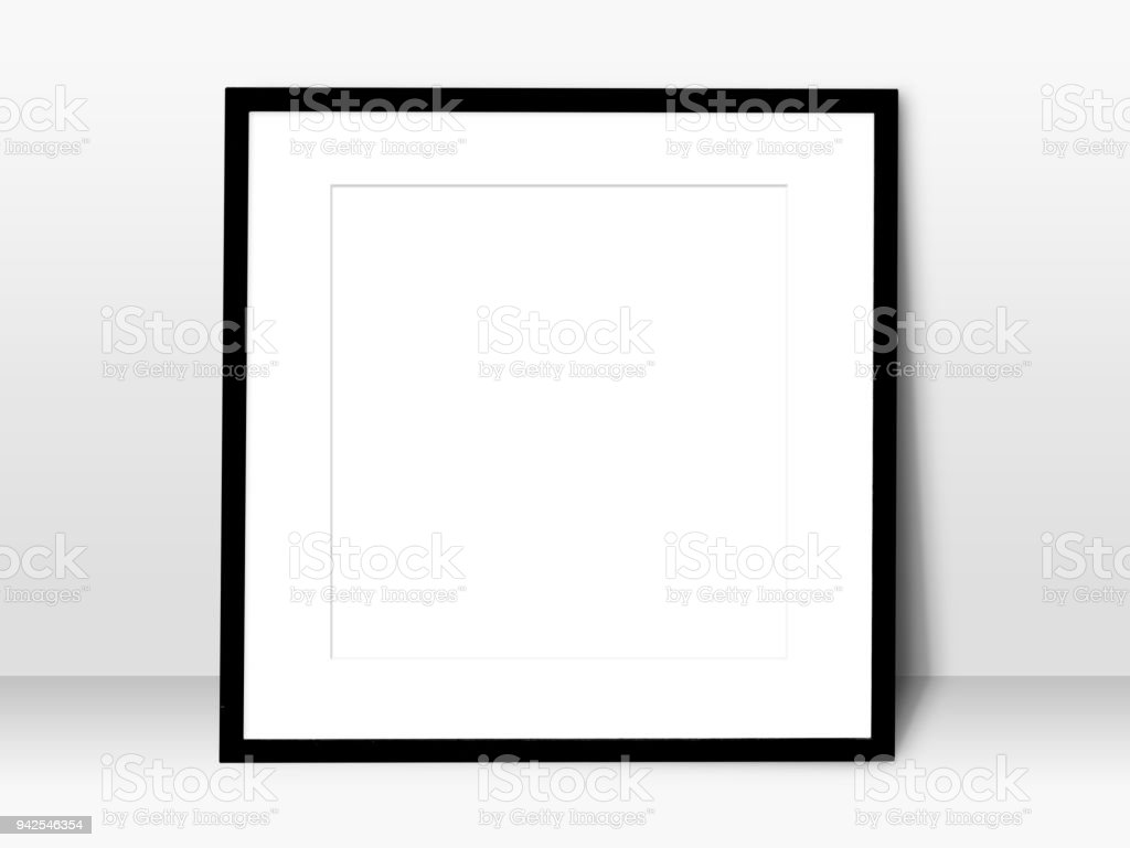 empty white space in black blank frame leaning against with white wall. simple blank photo frame for presentation or decorate background stock photo