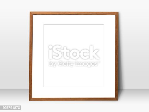 istock empty white space in wooden blank frame leaning against with white wall. simple blank photo frame for presentation or decorate background 953751870