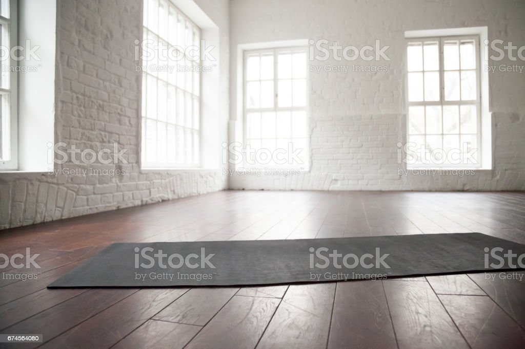Empty white space, loft studio, yoga mat on the floor stock photo