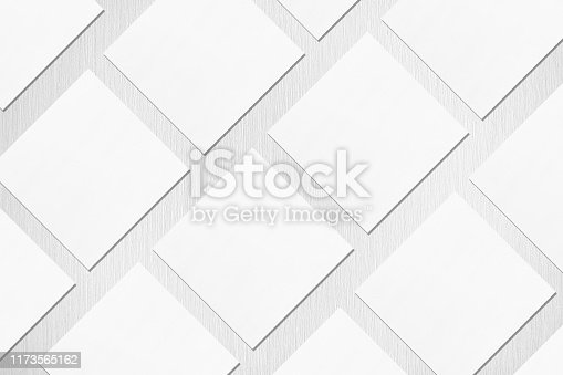 1173565159 istock photo empty white square business card mockups lying diagonally on neutral light grey textured background 1173565162