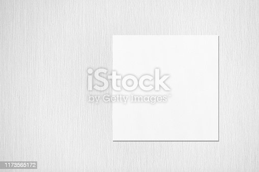 1173565159 istock photo Empty white square flyer or business card mockup with soft shadows on neutral light grey textured background 1173565172