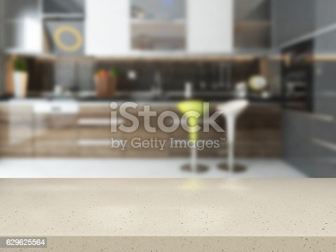 istock empty white stone desk with blurred kitchen 629625564