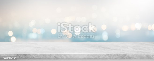 Empty white stone marble table top and blurred abstract bokeh light banner background - can used for display or montage your products.