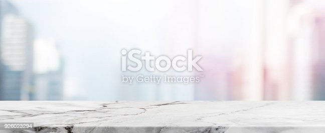 662984906istockphoto Empty White Stone table top and blur glass window wall building banner mock up background - can used for display or montage your products. 926023294