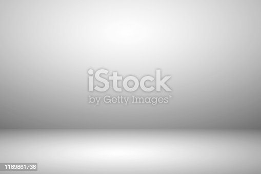 istock Empty white studio room with light and shadow abstract background. Copy space studio room for present your products. 1169861736