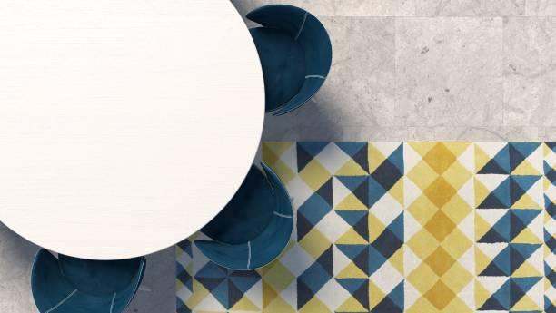 leere weiße tischplatte mit blauen sessel stehen auf dem betonboden mit geometrisch gemusterten teppich - teppich geometrisch stock-fotos und bilder