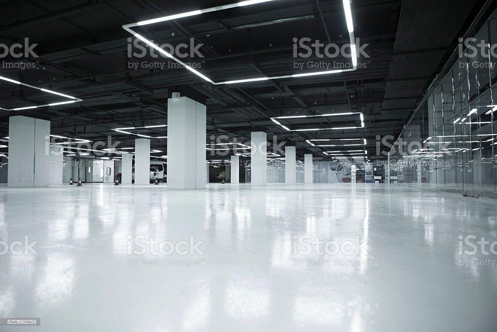 empty white underground parking stock photo