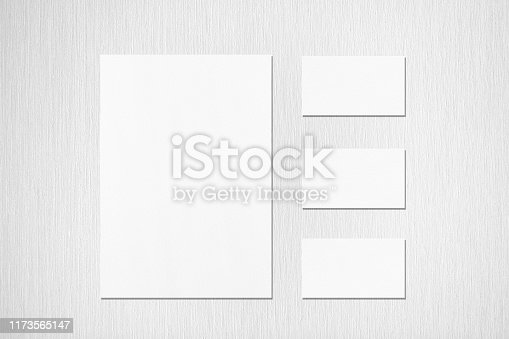 istock empty white vertical a4 sized poster and three horizontal rectangle business card mockups on neutral light grey textured background 1173565147