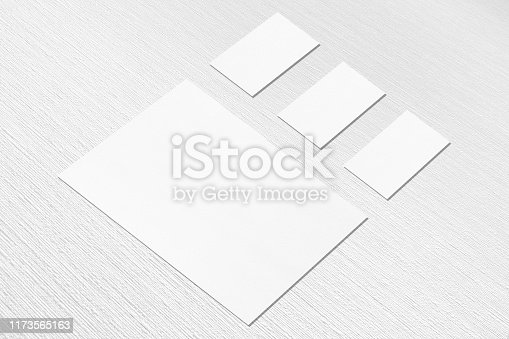 istock empty white vertical a4 sized poster and three horizontal rectangle business card mockups on neutral light grey textured background 1173565163