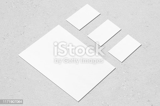 istock empty white vertical poster and horizontal rectangle business card mockups in isometric composition 1171907064