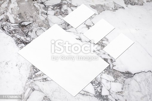 istock empty white vertical poster and horizontal rectangle business card mockups in isometric composition 1172689825