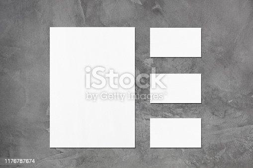 istock empty white vertical poster and horizontal rectangle business card mockups 1176787674