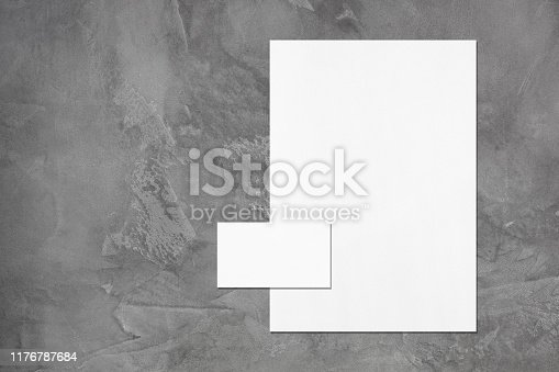 istock empty white vertical poster and horizontal rectangle business card mockup 1176787684