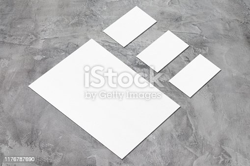 istock empty white vertical poster and horizontal rectangle business card mockups in isometric composition 1176787690
