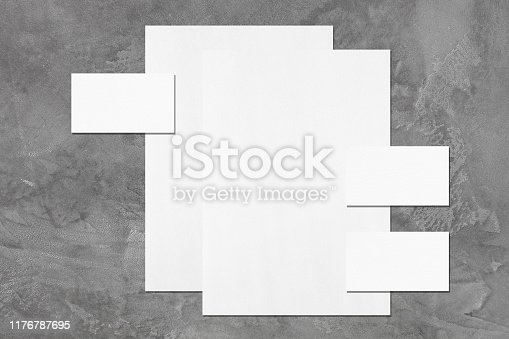 1173565159 istock photo empty white vertical poster and horizontal rectangle business card mockups 1176787695