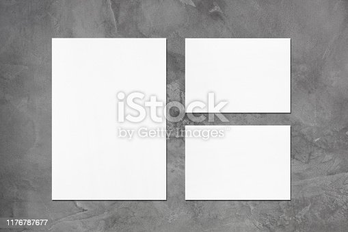 istock empty white vertical poster and two horizontal rectangle card mockups 1176787677