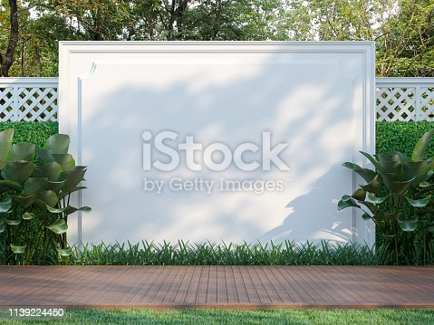 1136239089 istock photo Empty white wall in the garden 3d render 1139224450