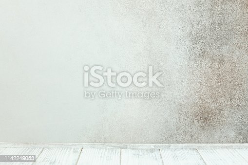 834157738 istock photo Empty white wooden table in front of stone wall 1142249053