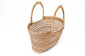 empty wicker basket isolated on white background.