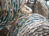 Empty wicker baskets with the handle. White baskets