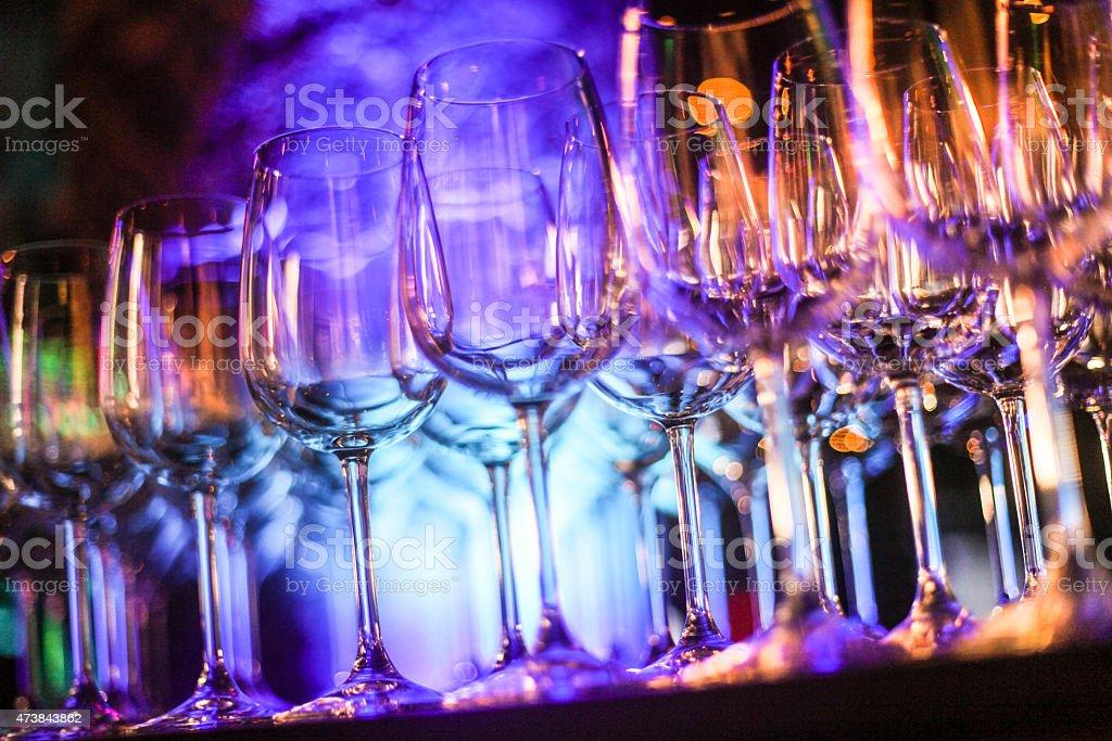 Empty wine glasses against multi colored background stock photo
