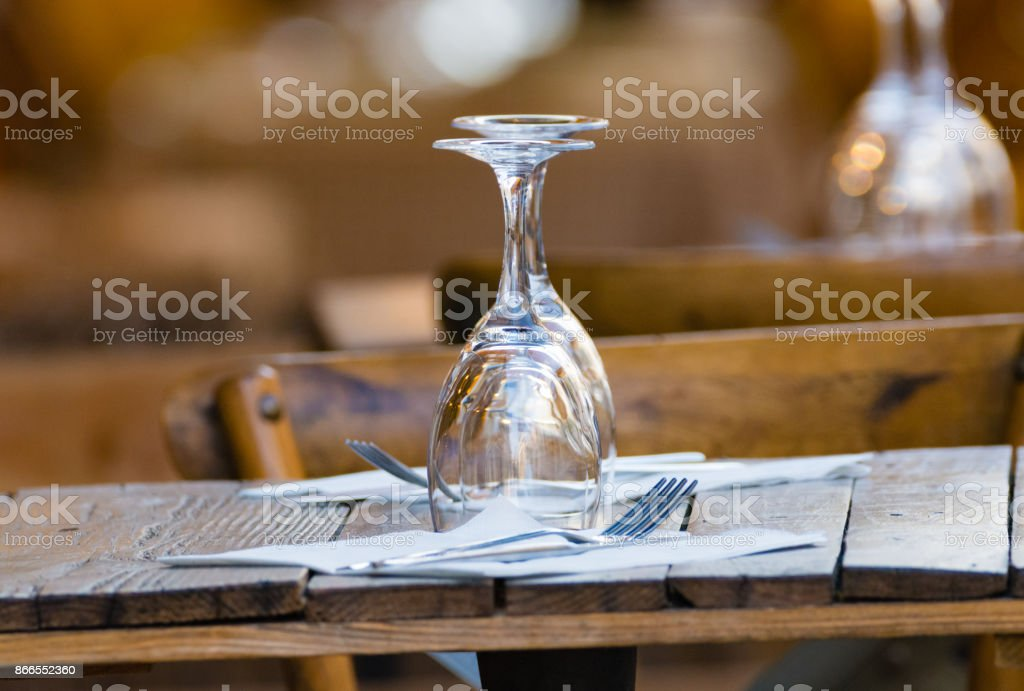 Empty wine glasses on the table served for lunch, dinner in cafe, restaurant outside or on terrase stock photo