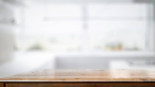 empty wood counter table in white kitchen room background. - food delivery стоковые фото и изображения