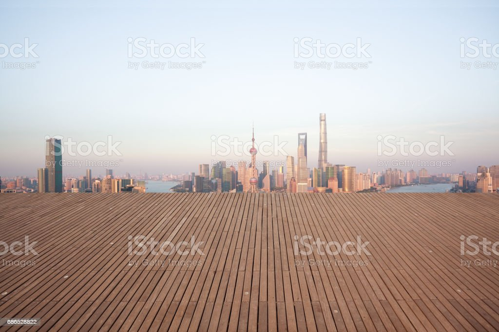Empty wood floor with modern city landmark buildings of Shanghai bund Skyline zbiór zdjęć royalty-free