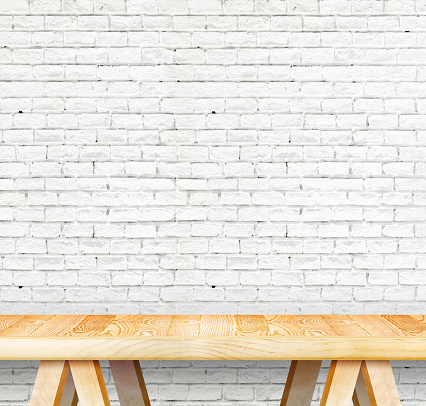 593305530 istock photo Empty wood modern table and grunge white brick wall 487408558