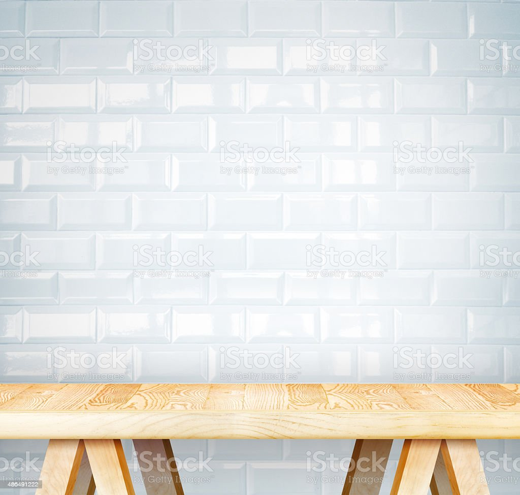 Empty wood modern table and white ceramic tile wall stock photo