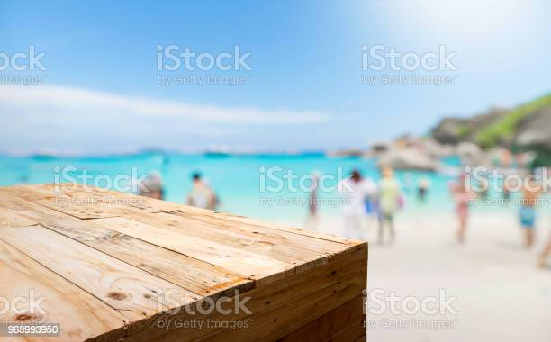 Empty wood plank table food stand with blur tourist on sand beach for picture id968993950?b=1&k=6&m=968993950&s=612x612&h=q83zwsfqd8lg teuxur119hg3e0uadttrikwl4bgwhq=
