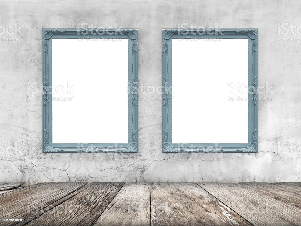 Empty wood plank with two vintage canvas frame on old concrete wall background. Product display template. Business presentation background concept. stock photo