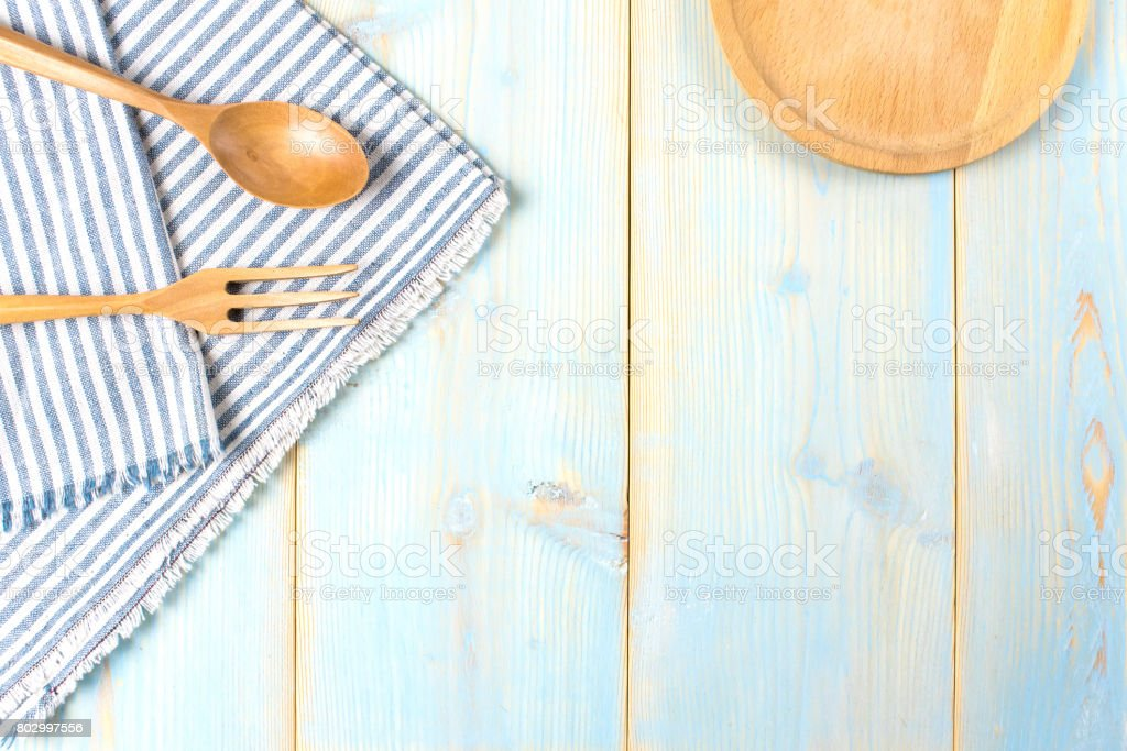 Empty Wood Plate, Fork, Spoon,tablecloth On Wood Table, Top View,