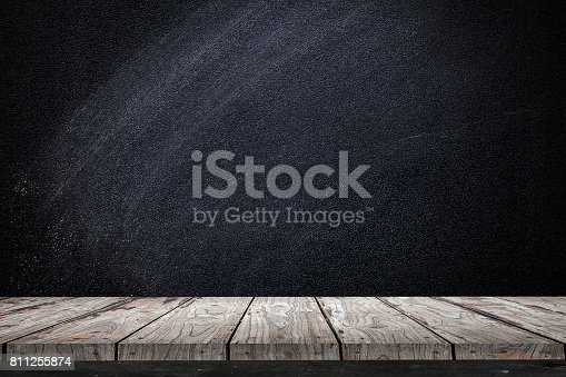 istock Empty wood Shelf on chalkboard wall background 811255874
