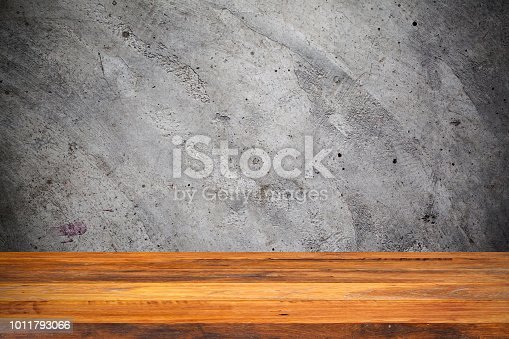 642100994istockphoto Empty wood Shelf on concrete wall background 1011793066