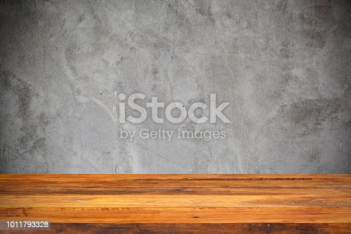 642100994istockphoto Empty wood Shelf on concrete wall background 1011793328