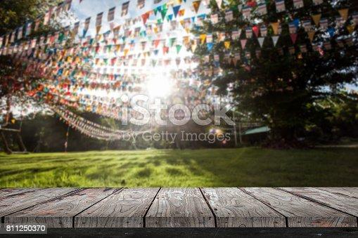 istock Empty wood Shelf on flags in garden background 811250370