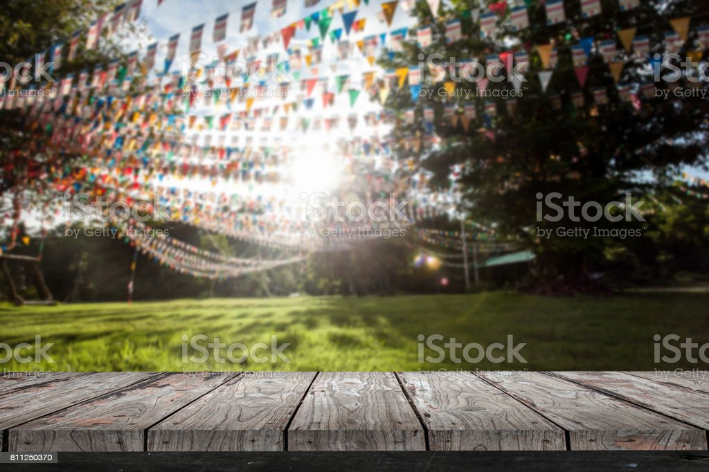 Empty wood Shelf on flags in garden background stock photo