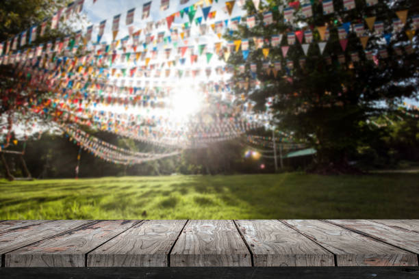 empty wood shelf on flags in garden background - film festival stock photos and pictures