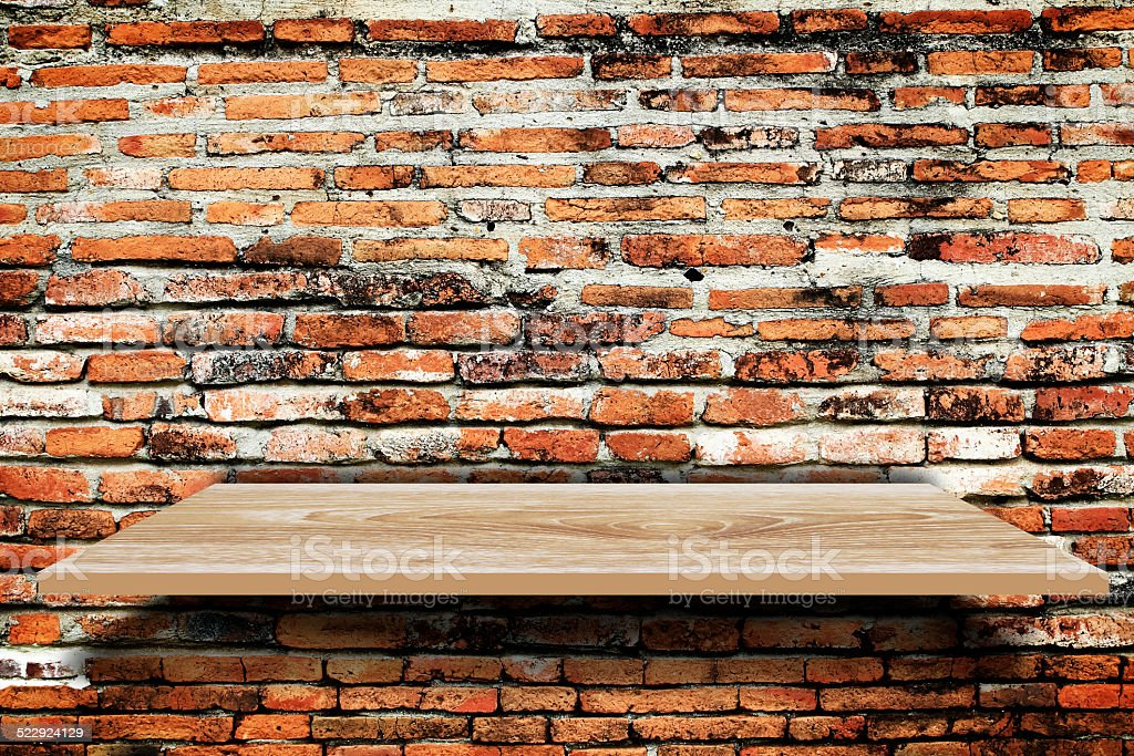 Empty wood shelf on old brick wall background stock photo