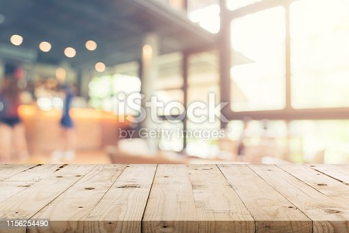 istock Empty wood table and Blurred background : Customer at coffee shop blur background with bokeh, Vintage toned. 1156254490