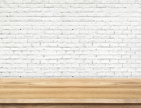593305530 istock photo Empty wood table and white brick wall in background 485037954